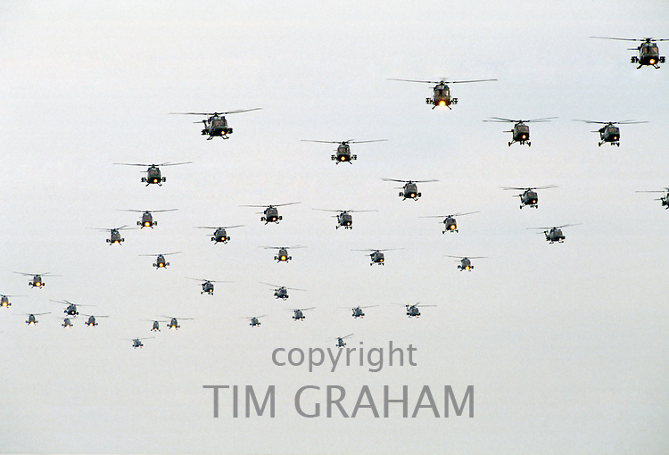 Air display of army helicopters including attack helicopters in the sky above England, UK