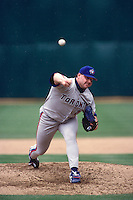 OAKLAND, CA - Roger Clemens of the Toronto Blue Jays in action during a game against the Oakland Athletics at the Oakland Coliseum in Oakland, California in 1998. Photo by Brad Mangin
