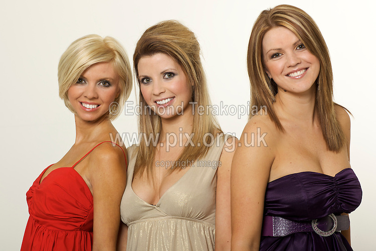 Lottery winner Sarah Cockings (centre - in gold) bought her sisters (L-R) Emma (in red) and Alex Cockings breast implants with part of her £3 million win. Photographed at Lomas Studios, Newcastle. March 31, 2009. Photo: Edmond Terakopian