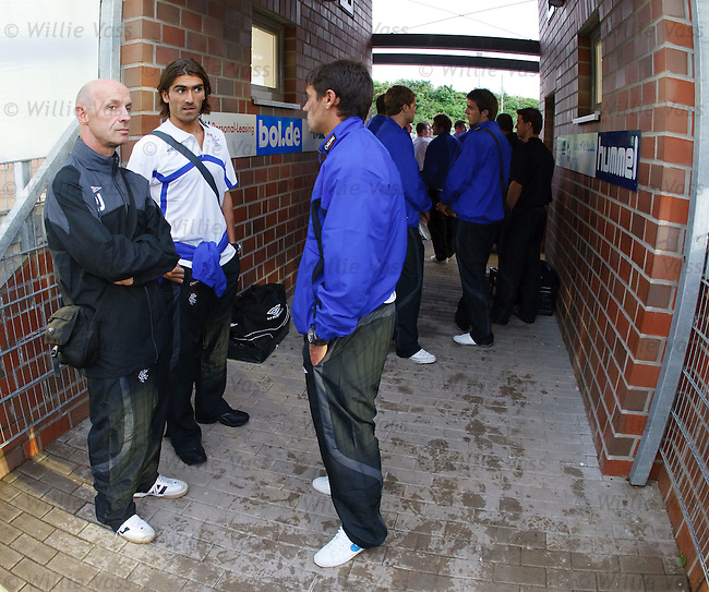 Paul Jackson , Pedro Mendes and Nacho Novo await news in the tunnel before the match is abandoned