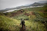 A FARDC soldier patrols the hills around the Mugunga IDP site, outside Goma, DRC.