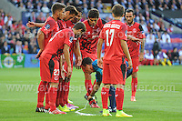 Cardiff City Stadium, Cardiff, South Wales - Tuesday 12th Aug 2014 - UEFA Super Cup Final - Real Madrid v Sevilla - <br /> <br /> The Sevilla defence look on with interest as Referee Mark Clattenburg marks out the line with the disappearing foam. <br /> <br /> <br /> <br /> <br /> Photo by Jeff Thomas/Jeff Thomas Photography