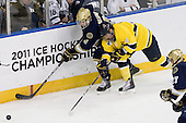 Riley Sheahan (Notre Dame - 4), Jordan Heywood (Merrimack - 4) - The University of Notre Dame Fighting Irish defeated the Merrimack College Warriors 4-3 in overtime in their NCAA Northeast Regional Semi-Final on Saturday, March 26, 2011, at Verizon Wireless Arena in Manchester, New Hampshire.
