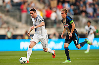 Robbie Keane (7) of the Los Angeles Galaxy is marked by Brian Carroll (7) of the Philadelphia Union. The Los Angeles Galaxy defeated the Philadelphia Union 4-1 during a Major League Soccer (MLS) match at PPL Park in Chester, PA, on May 15, 2013.