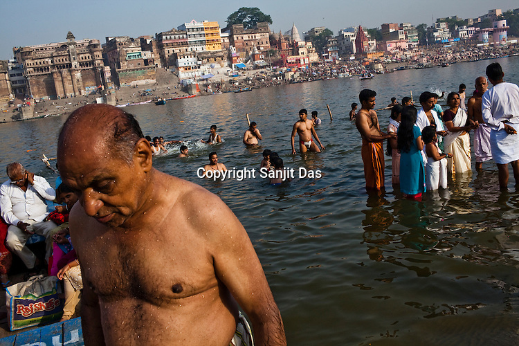 Pilgrims take a holy dip in river Ganges in the ancient city of Varanasi in Uttar Pradesh, India. Photograph: Sanjit Das/Panos