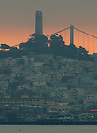 The morning sun illuminates the background as the city awakes in the  North Beach district of San Francisco.