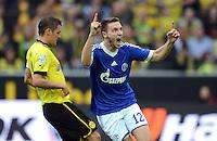Fussball 1. Bundesliga :  Saison   2012/2013   8. Spieltag  20.10.2012 Borussia Dortmund - FC Schalke 04 Jubel nach dem Tor zum 0:2 , Enttaeuschung bei Sebastian Kehl (li, Borussia Dortmund) und  Marco Hoeger (v. li., FC Schalke 04)