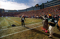 """As the NFC Championship game between the Green Bay Packers and the Carolina Panthers commences, Paul Hornung throws his jacket into the end zone and prepares to execute a Lambeau Leap on January 12, 1997. This was the first title game in Green Bay since the """"Ice Bowl"""" in 1967."""