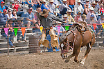 Ryan McKenzie hops off his bucking saddle bronc--saddle bronc riding, Jordan Valley Big Loop Rodeo, Ore...