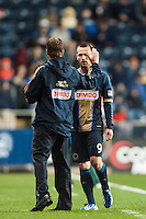 Philadelphia Union manager John Hackworth high fives Jack McInerney (9) after he was subbed out in the 90th minute. The Philadelphia Union defeated the Chicago Fire 1-0 during a Major League Soccer (MLS) match at PPL Park in Chester, PA, on May 18, 2013.