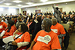 "Feb. 25, 2013 - Mineola, New York, U.S. - Front row, L to R in orange shirts, CHAVON DARRELL, EUNICE REDD, JOE LOUIS BROWN, all of Hempstead, are members of the New York Community for Change organization attending Nassau County Legislature meeting to show they are against the controversial Redistricting Map proposed by Republicans. When a short recess was announced, LINDA JOHN, of Hempstead, standing ar right, asked audience, ""How many of you are against the redistricting plan?"" and many clapped their hands. The legislature postponed the vote on the map shortly before 1 AM the morning of February 26, nearly 12 hours after the meeting started on 1:30 PM Feb. 25."