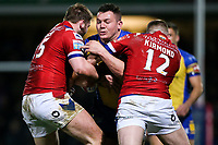 Picture by Alex Whitehead/SWpix.com - 17/03/2017 - Rugby League - Betfred Super League - Leeds Rhinos v Wakefield Trinity - Headingley Carnegie Stadium, Leeds, England - Leeds' Brett Ferres is tackled by Wakefield's Anthony Walker and Danny Kirmond.