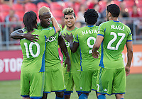 August 10, 2013: Seattle Sounders FC players celebrate a goal by Seattle Sounders FC midfielder Mauro Rosales #10 during an MLS regular season game between the Seattle Sounders and Toronto FC at BMO Field in Toronto, Ontario Canada.
