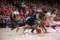 18 January 2012:  San Diego State #22 Chase Tapley and others dive for the ball early in the first half of play. San Diego State Aztecs defeated the New Mexico Lobos Lobos 75 - 70 at The Pit in Albuquerque, NM.