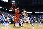 26 January 2015: Syracuse's Rakeem Christmas (25) and North Carolina's J.P. Tokoto (13). The University of North Carolina Tar Heels played the Syracuse University Orange in an NCAA Division I Men's basketball game at the Dean E. Smith Center in Chapel Hill, North Carolina. UNC won the game 93-83.