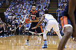 18 February 2017: Virginia's London Perrantes (32) and North Carolina's Seventh Woods (21). The University of North Carolina Tar Heels hosted the University of Virginia Cavaliers at the Dean E. Smith Center in Chapel Hill, North Carolina in a 2016-17 Division I Men's Basketball game. UNC won the game 65-41.