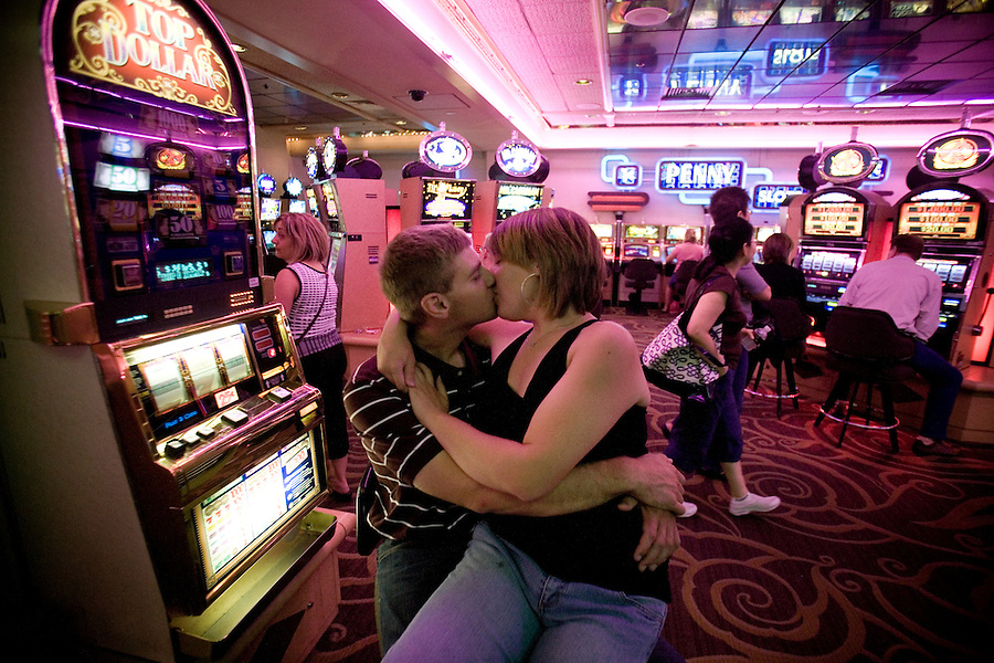 A young couple smooch in a casino in Las Vegas, Nevada.