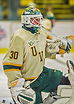 29 December 2013:  University of Vermont Catamount Goaltender Pat Feeley, a Freshman from Winthrop, MA, warms up prior to the final game of the Catamount Cup NCAA Hockey Tournament against the Canisius College Golden Griffins at Gutterson Fieldhouse in Burlington, Vermont. The Catamounts defeated the Golden Griffins 6-2 to win the 2013 Sheraton/TD Bank Catamount Catamount Cup. Mandatory Credit: Ed Wolfstein Photo *** RAW (NEF) Image File Available ***