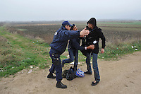 A policeman separates two illegal immigrants who were just released from the detention centre in Fylakio. According to UNHCR, 38,992 immigrants arrived in Greece in the first 10 months of 2010, whereas in 2009 the number was only 7,574.
