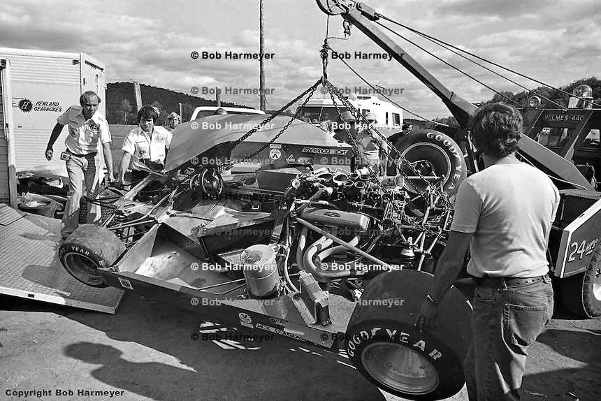 The crashed car of Brian Redman, a 1977 Lola Chevrolet Can-Am car, arrives back in the pit area at Le Circuit Mont Tremblant,St. Jovite, Quebec, Canada.