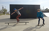 NWA Democrat-Gazette/BEN GOFF @NWABENGOFF<br /> Jacob Morrison (left), and brother Justin Morrison of Garfield skate Thursday, March 16, 2017, at the Rogers Skate Park next to the Rogers Activity Center.