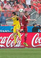 July 27, 2013: Columbus Crew midfielder Bernardo Anor #7 and Toronto FC defender Steven Caldwell #13 in action during an MLS regular season game between the Columbus Crew and Toronto FC at BMO Field in Toronto, Ontario Canada.<br /> Toronto FC won 2-1.