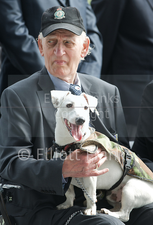 Raising the flag for Armed Forces Day <br /> at City Hall, London, Great Britain <br /> <br /> 20th June 2011<br /> <br /> Ron Kane (84 years old)<br /> ex RAF &amp; Army <br /> and his dog Benji<br /> <br /> Photograph by Elliott Franks