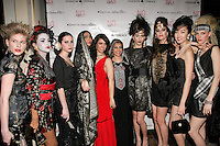 Photographer Carrie Schechter (red dress), poses with models during the EngieStyle one year anniversary, &quot;A Tale of the Black Dress&quot;, fashion presentation.