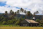 Maui, Hawaii.  The Keanae Peninsula where rough, black lava meets the gorgeous, blue ocean.  Home to a small community of Taro farmers.  Pictured here is the local church made from lava rock and surrounded by coconut palms.