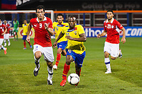 Cristian Benitez (11) of Ecuador is marked by Marcos Gonzalez (3) of Chile. Ecuador defeated Chile 3-0 during an international friendly at Citi Field in Flushing, NY, on August 15, 2012.