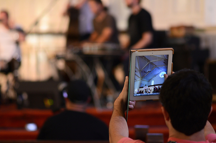 An audience member takes a photo of Jon Mueller's Death Blues with his iPad during the Hometapes Friend Island III day party. Hopscotch Music Festival, September 7, 2012.