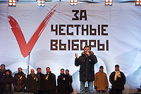 "Moscow, Russia, 24/12/2011..Opposition politician Boris Nemtsov speaks to an estimated crowd of up to 100,000 gathered to protest against election fraud and Prime Minister Vladimir Putin in the largest anti-government demonstration in Russia since the collapse of the Soviet Union. The banner behind reads ""For Honest Elections""."
