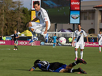 Todd Dunivant of Galaxy leaps over Steven Beitashour of Earthquakes during the game at Buck Shaw Stadium in Santa Clara, California on October 21st, 2012.  San Jose Earthquakes and Los Angeles Galaxy tied at 2-2.