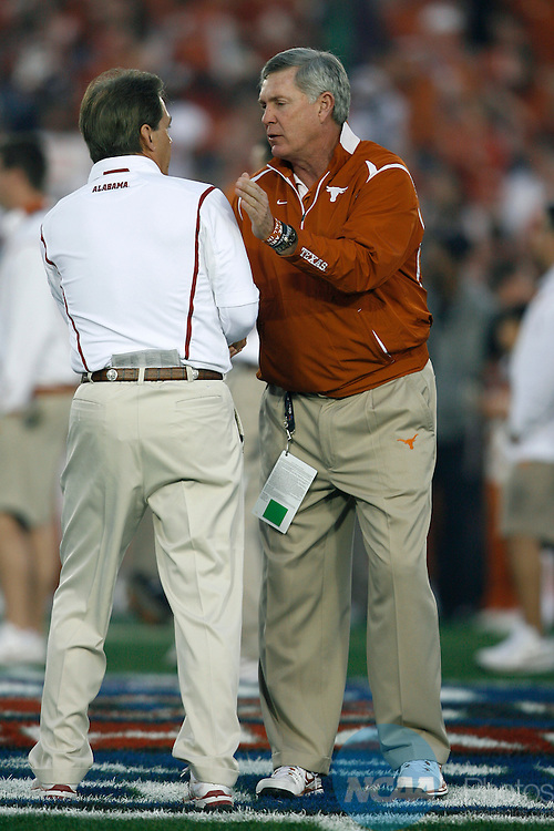 07 JAN 2010:  Head coaches Nick Saban (3) of the University of Alabama and Mack Brown of the University of Texas greet each other prior to the BCS National Championship held at the Rose Bowl in Pasadena, CA.  Alabama defeated Texas 37-21 for the national title. Jamie Schwaberow/NCAA Photos
