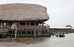 Ganvie, Benin, with some 3,000 stilted buildings and a population of 20,000-30,000 people, may be the largest &quot;lake vllage&quot; in Africa.  In Ganvie, the population lives exclusively from fishing, building houses on stilts in and next to Lake Nokoue.  Because the Dan-Homey religion prohibited attacks on communities living in the water, the village of Ganvie dates back to the 16th or 17th century, when it was built to protect people from slavery.  Yet, even Ganvie hasn't escaped Coca Cola!!!