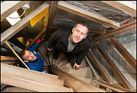 BNPS.co.uk (01202 558833)<br /> Pic: TomWren/BNPS<br /> <br /> Clerk of the Works, Gary Price (right) and Ecclesiastical carpenter Richard Pike climb the wooden stairs to the bottom of the spire.<br /> <br /> How many men does it take to change a lightbulb... at the top of Britain's tallest spire.<br /> <br /> When your office is Salisbury Cathedral the simple task of changing a light bulb involves four men, a 404ft climb and takes three hours.<br /> <br /> Ecclesiastical carpenter Richard Pike needed a head for heights when he joined Gary Price, who is in charge of conservation, to make the daring ascent with two rope specialists to ensure their safety. <br /> <br /> Despite working at the cathedral for 27 years, it was the first time Richard has ever made the hair-raising climb.