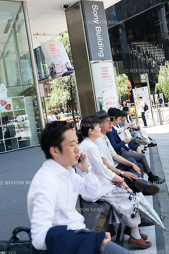 People sit outside  the Sony Building in Ginza on June 17, 2016, Tokyo, Japan. Sony announced plans to tear down its Ginza landmark building and replace it with a park whose concept will be similar to the stairs in New York's Time Square. On Monday, the company said that demolition would start in spring 2017 and be concluded by summer 2018. Sony's public park would then operate until after the Olympic Games in 2020. Kazoo Hirai, President and CEO of Sony, said that after the Games, Sony would construct a new building on the land. The current Sony Building was constructed in 1966 and attracts around 4 million visitors each year. (Photo by Rodrigo Reyes Marin/AFLO)