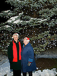 TORRINGTON, CT- 28 November 2014-112814EC06--   Evelyn Lukes (L) and Gloria Novak (R) pose for a picture in front of the Coe Memorial Park Christmas tree in Torrington. The two volunteers helped the city with the holiday display at City Hall. Friday night's event brought hundreds to downtown Torrington Friday night. Mayor Elinor Carbone helped countdown to the lighting, then attendees walked down Main Street to see the City Hall tree lit and hear music. Erin Covey Republican-American