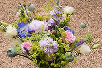 Cut flower arrangement with roses Rosa, Alchemilla, phlox, Poppies Papaver, Ammi, etc