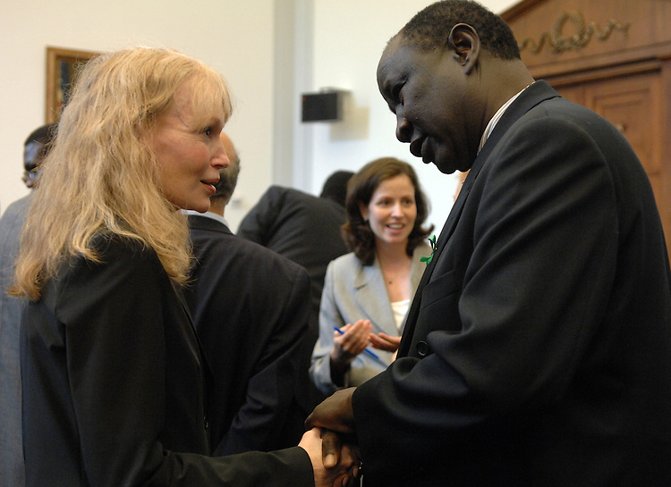 Actress and UNICEF goodwill ambassador Mia Farrow, speaks with Abdelgabr Adam, president of Darfur Human Rights Organization of the USA, talk before a panel discussion on Africa regarding Darfur, Somolia and Ethiopia.