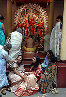 INDIA (West Bengal - Calcutta)  2006, An old lady meet up a relative at Mullick family (one of the well known families in South Calcutta) after a long on the occassion of Durga Puja Festival.  Durga Puja is a festival of reunion among bengalis. Durga Puja Festival is the biggest festival among bengalies.  As Calcutta is the capital of West Bengal and cultural hub of  the bengali community Durga puja is held with the maximum pomp and vigour. Ritualistic worship, food, drink, new clothes, visiting friends and relatives places and merryment is a part of it. In this festival the hindus worship a ten handed godess riding on a lion armed wth all possible deadly ancient weapons along with her 4 children (Ganesha - God for sucess, Saraswati - Goddess for arts and education, Laxmi - Goddess of wealth and prosperity, Kartikeya - The god of manly hood and beauty). Durga is symbolised as the women power in Indian Mythology.  In Calcutta people from all the religions enjoy these four days of festival in the moth of October. Now the religious festival has become the biggest cultural extravagenza of Calcutta the cultural capital of India. Artistry and craftsmanship can be seen in different sizes and shapes in form of the idol, the interior decor and as well as the pandals erected on the streets, roads and  parks.- Arindam Mukherjee