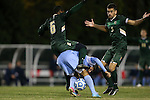 21 November 2013: USF's Duane Muckette (TRI) (6) and North Carolina's Raby George (SWE) (below) get tangled up challenging for the ball as Samuel Hosseini (GER) (5) watches. The University of North Carolina Tar Heels hosted the University of South Florida Bulls at Fetzer Field in Chapel Hill, NC in a 2013 NCAA Division I Men's Soccer Tournament First Round match. North Carolina won the game 1-0.