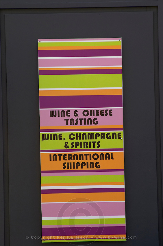 Wine shop. Modern, owned by JL thunevin, sign for cheese and wine tasting and international shipping. The town. Saint Emilion, Bordeaux, France