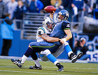 Seattle Seahawks quarterback Matt Hasselbeck is sacked by Dan Morgan of the Carolina Panthers during the first quarter of the NFC Championship game.