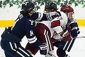 Mitchell Smith (Yale - 14), Sean Malone (Harvard - 17), Adam Larkin (Yale - 2) - The Harvard University Crimson tied the visiting Yale University Bulldogs 1-1 on Saturday, January 21, 2017, at the Bright-Landry Hockey Center in Boston, Massachusetts.