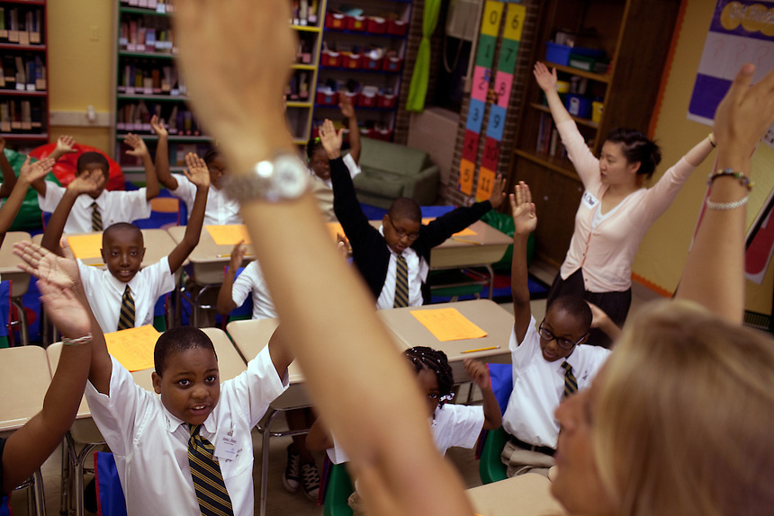 Stephanie Frost, far right, teaches her third-graders a school cheer on the first day of class at Brownsville Elementary School in Brooklyn, NY on August 15, 2011.