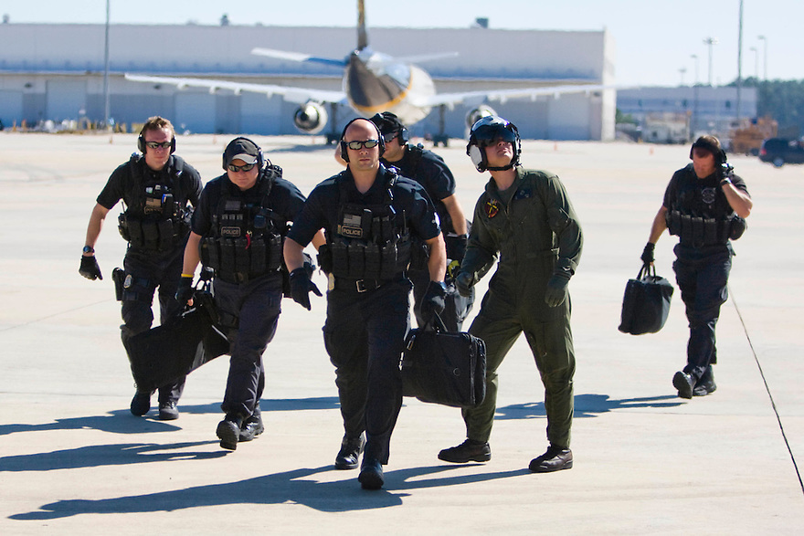 Members of the Counter Assault and Tactical Division of the Secret Service board a helicopter in Houston as they follow President Obama...Photo by Brooks Kraft/Corbis.......................