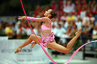 Marina Shpekt of Russia split leaps during ribbon event final at 2006 Portimao World Cup of Rhythmic Gymnastics on September 10, 2006.