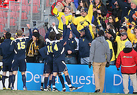Players and fans of the University Michigan celebrate their victory during an NCAA quarter-final match against the University of Maryland at Ludwig Field, University of Maryland, College Park, Maryland on December 4 2010.Michigan won 3-2 AET.