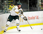 9 January 2011: University of Vermont Catamount defenseman Drew MacKenzie, a Junior from New Canaan, CT, in action against the Boston University Terriers at Gutterson Fieldhouse in Burlington, Vermont. The Catamounts fell to the Terriers 4-2 in Hockey East play. Mandatory Credit: Ed Wolfstein Photo